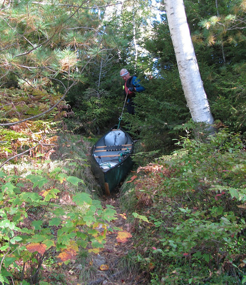 Jerry lowering canoe into Little Long Pond